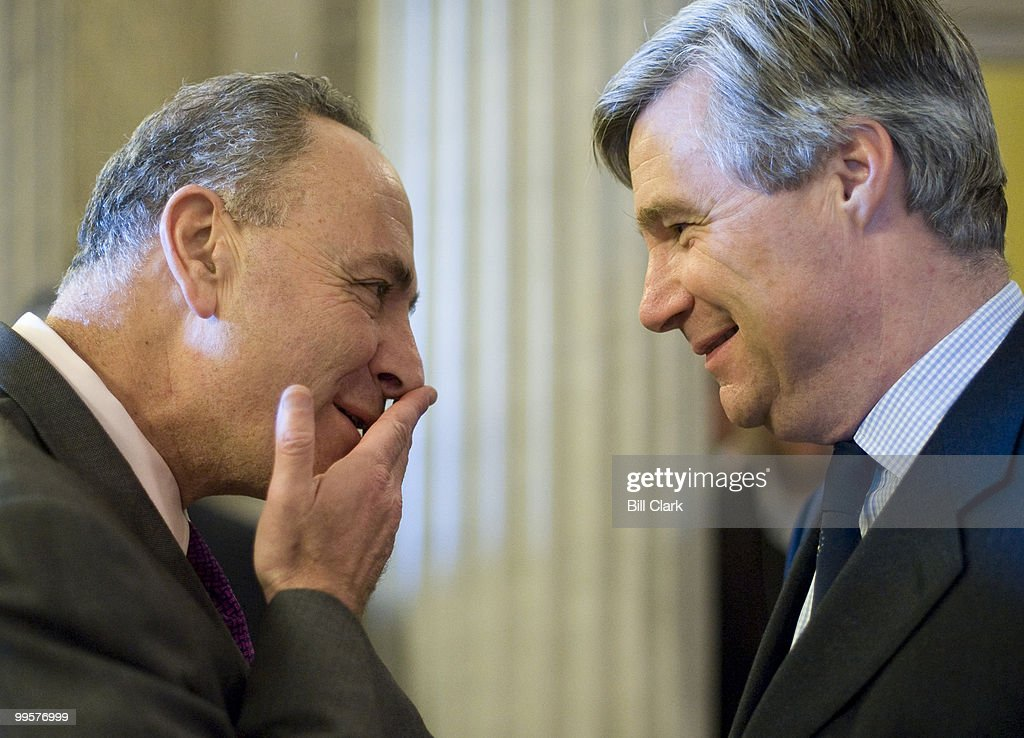 Sen. Chuck Schumer, D-N.Y., left, and Sen. Sheldon Whitehouse, D-R.I., talk outside of the Senate Floor before a vote on Tuesday, Dec. 1, 2009.