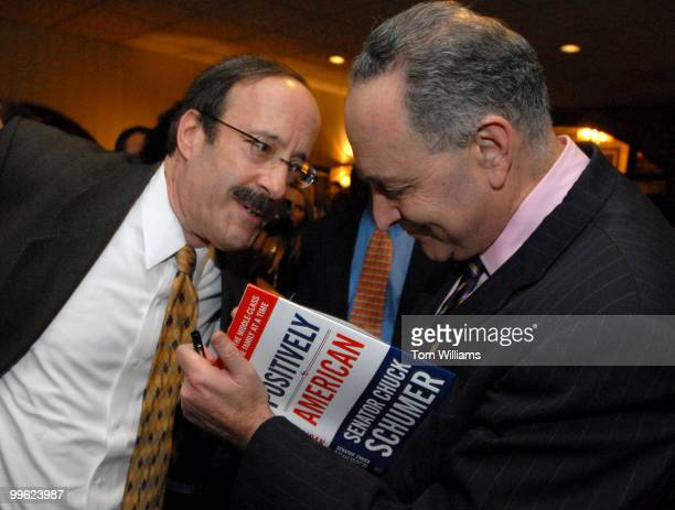 Sen Chuck Schumer DNY signs his new book Positively American for Rep Eliot Engel DNY at a booking signing reception at the Hunan Dynasty on Capitol...