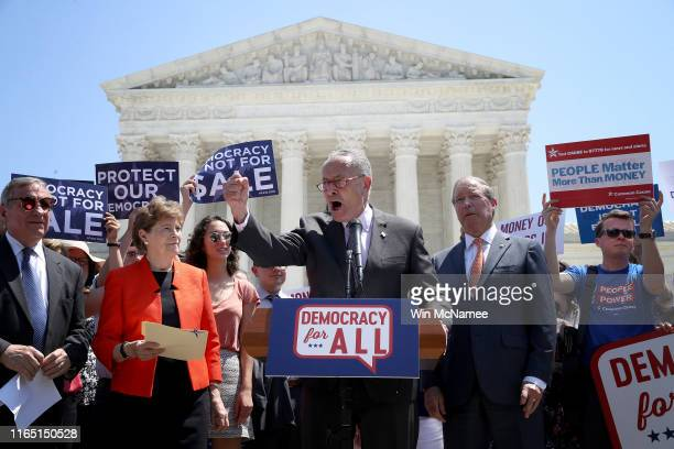 Sen Chuck Schumer speaks during a press conference outside the US Supreme Court July 30 2019 in Washington DC Schumer and other US Senate Democrats...