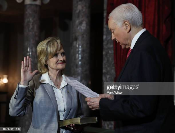 Sen Cindy HydeSmith is sworn in by Sen Orrin Hatch during a ceremonial swearing in inside the old Senate Chamber on December 17 2018 in Washington DC...