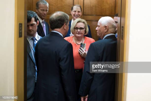 Sen Claire McCaskill DMo rides an elevator with Sens John Thune RSD Doug Jones DAla Ron Wyden DOre and Ben Cardin DMd in the Capitol's Senate subway...