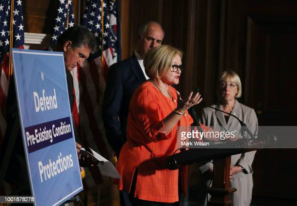 Sen Claire McCaskill speaks on a proposed protection plan for people with preexisting health conditions during a news conference on Capitol Hill July...