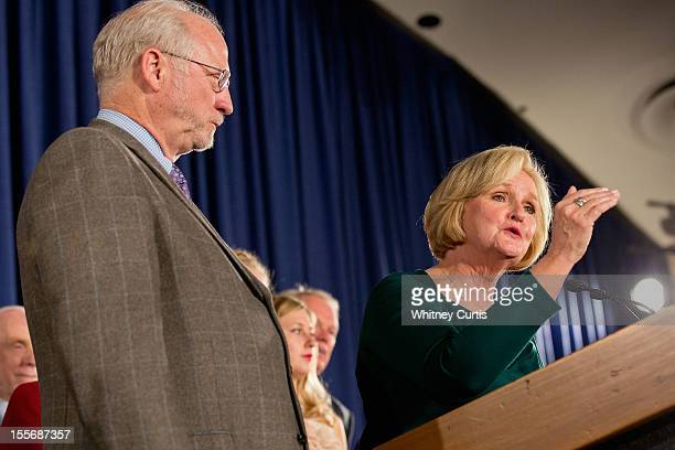 S Sen Claire McCaskill speaks to supporters next to her husband Joseph Shepard during an election night party November 6 2012 in St Louis Missouri...