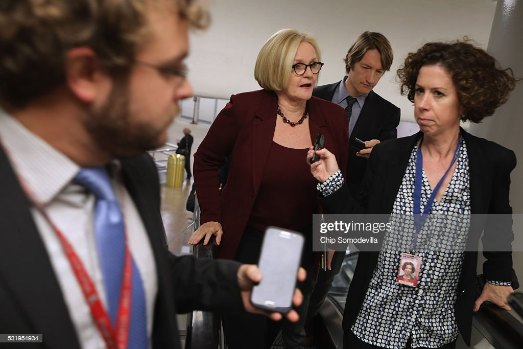 Sen. Claire McCaskill (D-MO) talks with reporters while heading to the weekly Senate Democratic policy luncheon at the U.S. Capitol May 17, 2016 in Washington, DC. Leaders from both sides of the aisle met behind closed doors for their weekly policy meetings.