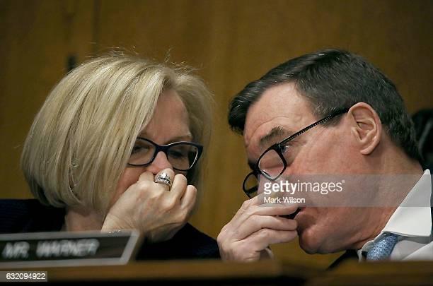 Sen Claire McCaskill talks with Sen Mark Warner while Treasury Secretary nominee Steven Mnuchin testifies during his Senate Finance committee...