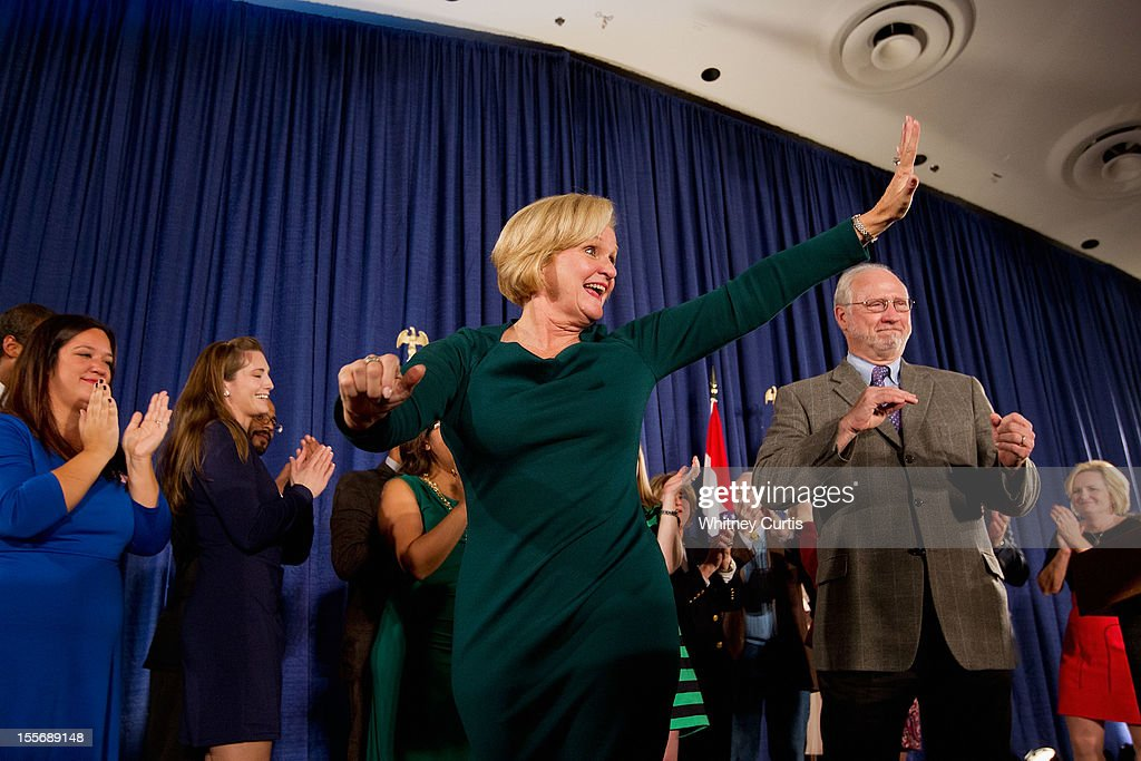 U.S. Sen. Claire McCaskill (D-MO) waves to supporters with her husband, Joseph Shepard (R) and other family members during an election night party November 6, 2012 in St. Louis, Missouri. McCaskill defeated Rep. Todd Akin (R-MO) for the Missouri U.S. senate seat.