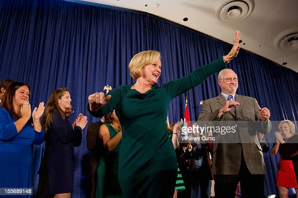 S Sen Claire McCaskill waves to supporters with her husband Joseph Shepard and other family members during an election night party November 6 2012 in...