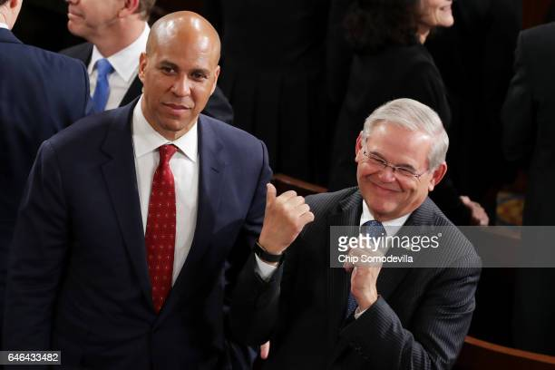 Sen Cory Booker and Sen Bob Menendez arrive to a joint session of the US Congress with US President Donald Trump on February 28 2017 in the House...