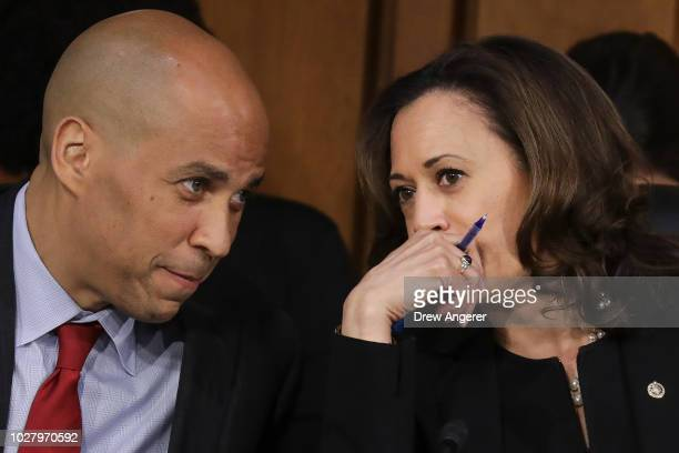 Sen Cory Booker and Sen Kamala Harris talk with each other as they listen to Supreme Court nominee Judge Brett Kavanaugh testify before the Senate...