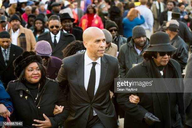 S Sen Cory Booker center president of the South Carolina NAACP chapter Brenda Murphy right and South Carolina Rep Annie McDonald left walk up the...