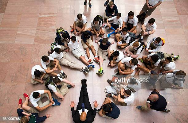 STATES MAY 24 Sen Cory Booker DNJ sits on the floor as he meets with 8th graders from Princeton Academy of the Sacred Heart on their end of year trip...