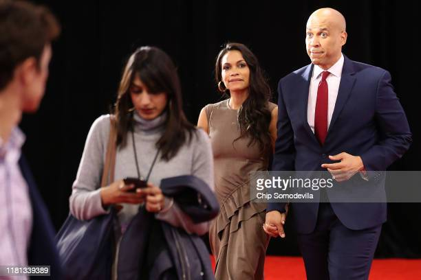 Sen Cory Booker enters the Spin Room with his girlfriend Rosario Dawson after the Democratic Presidential Debate at Otterbein University on October...