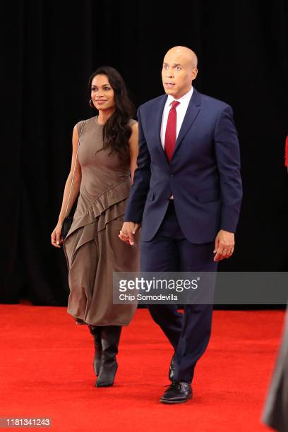 Sen. Cory Booker enters the Spin Room with his girlfriend Rosario Dawson after the Democratic Presidential Debate at Otterbein University on October...
