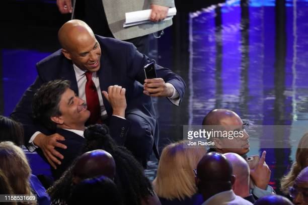 Sen Cory Booker greets a member of the audience after the first night of the Democratic presidential debate on June 26 2019 in Miami Florida A field...