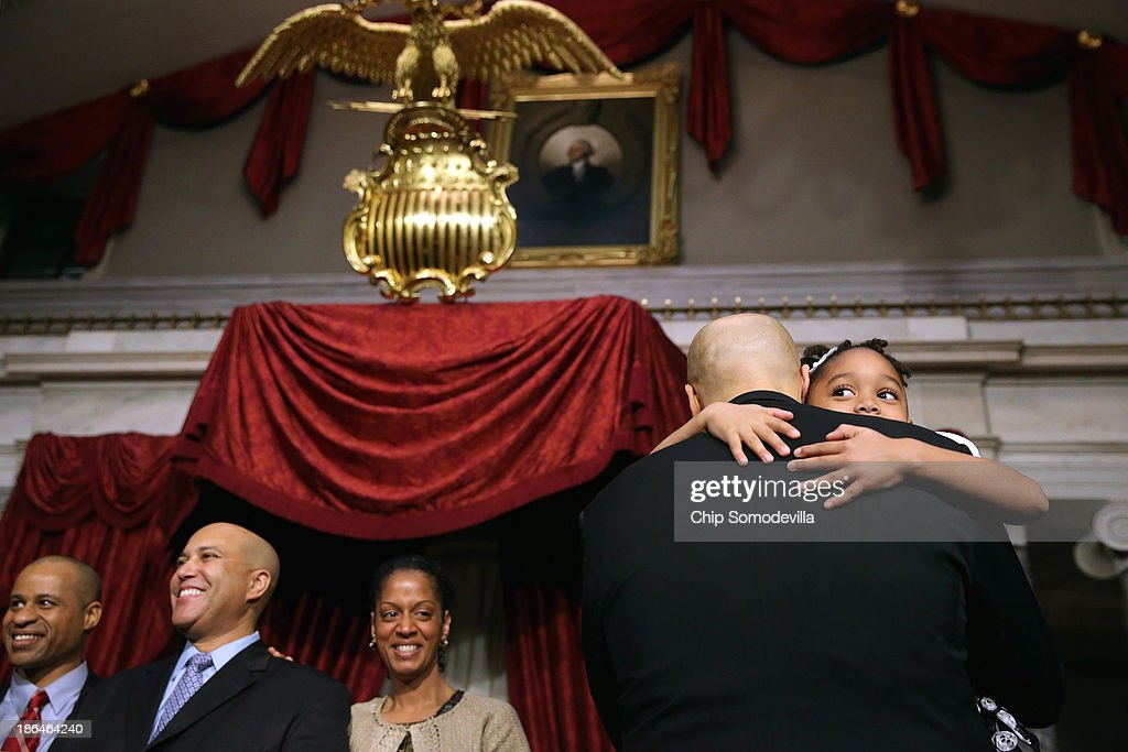 Sen. Cory Booker (D-NJ) holds his nerice Zelah Booker, 6, after his ceremonial swearing-in in the Old Senate Chamber at the U.S. Capitol October 31, 2013 in Washington, DC. Booker defeated Republican Steve Lonegan in a special election to replace Frank Lautenberg, who died in June.