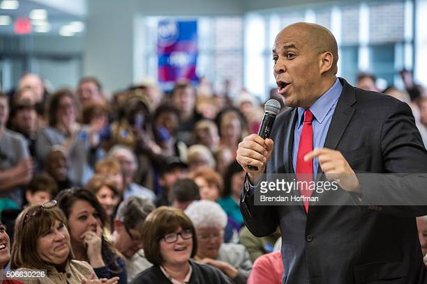 Sen Cory Booker introduces Democratic presidential candidate Hillary Clinton at a campaign event at Vernon Middle School on January 24 2016 in Marion...
