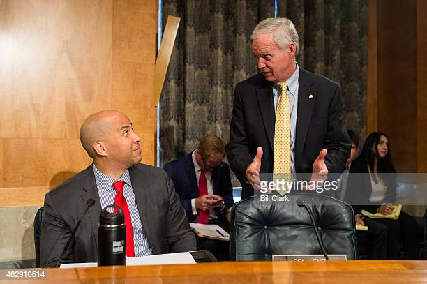 Sen Cory Booker left speaks with chairman Sen Ron Johnson during the Senate Homeland Security and Governmental Affairs Committee hearing on Oversight...