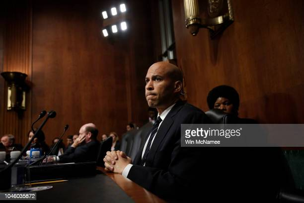 Sen Cory Booker listens to Republican senators speak after colleagues walked out of a Senate Judiciary Committee meeting due to a break in regular...