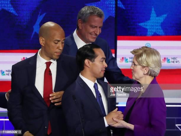 Sen Cory Booker New York City Mayor Bill De Blasio former housing secretary Julian Castro and Sen Elizabeth Warren shake hands after the first night...