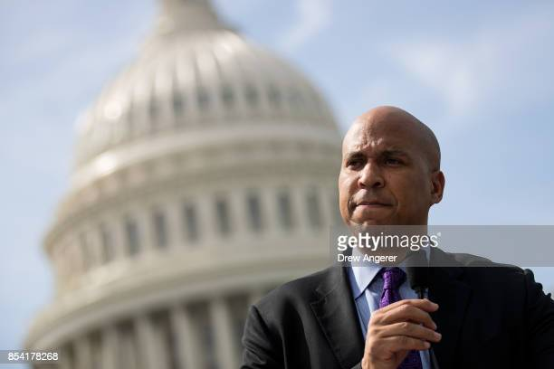Sen Cory Booker pauses while speaking during a news conference in opposition to the GrahamCassidy health care bill September 26 2017 in Washington DC...