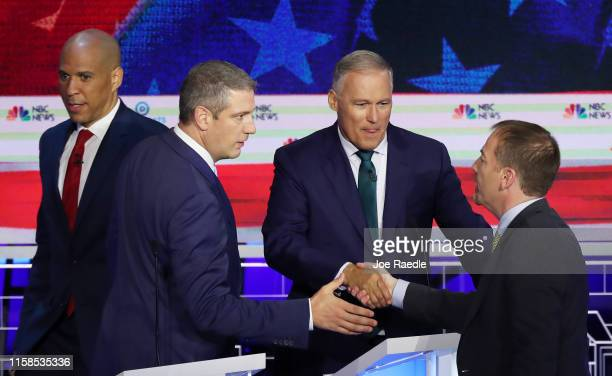 Sen Cory Booker Rep Tim Ryan and Washington Gov Jay Inslee greet Chuck Todd of NBC News after the first night of the Democratic presidential debate...