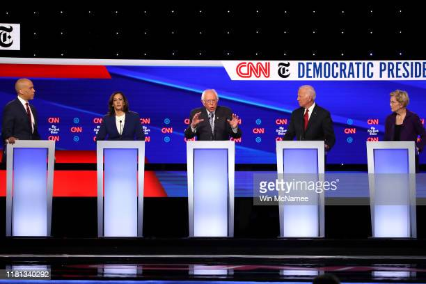 Sen Cory Booker Sen Kamala Harris Sen Bernie Sanders former Vice President Joe Biden and Sen Elizabeth Warren interact during the Democratic...