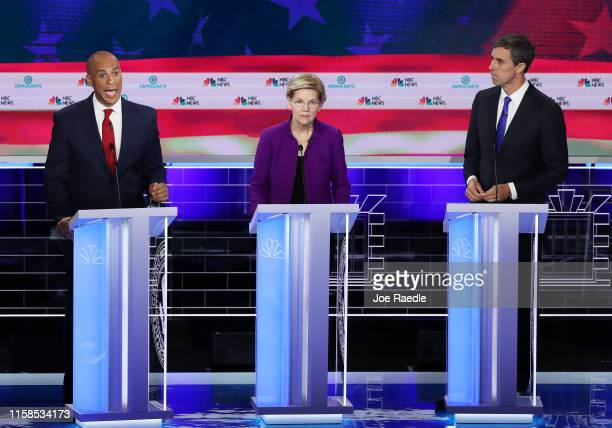 Sen Cory Booker speaks as Sen Elizabeth Warren and former Texas congressman Beto O'Rourke look on during the first night of the Democratic...