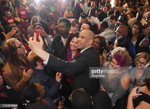 S Sen Cory Booker takes photos with people after speaking at his Conversation with Cory campaign event at the Nevada Partners Event Center on...