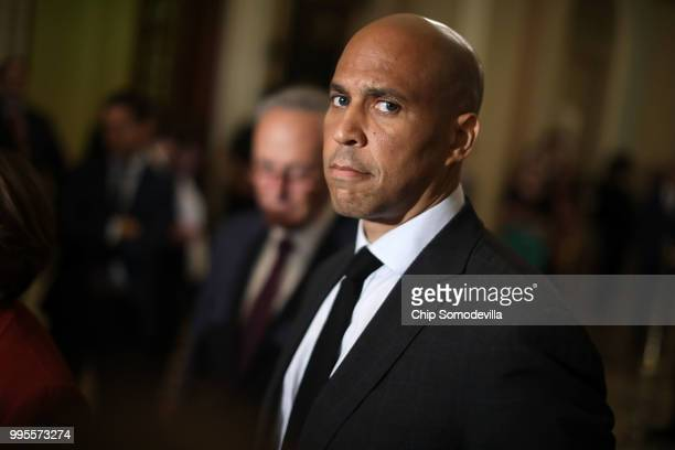 Sen Cory Booker talks with reporters following the weekly Democratic policy luncheon meeting at the US Capitol July 10 2018 in Washington DC...