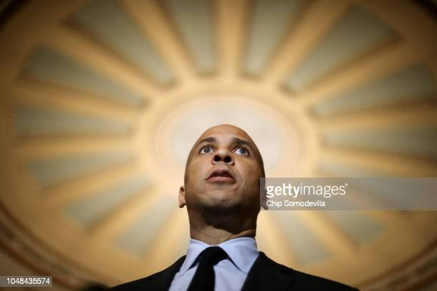Sen Cory Booker talks with reporters following the weekly Senate Democratic policy luncheon at the US Capitol October 02 2018 in Washington DC Senate...