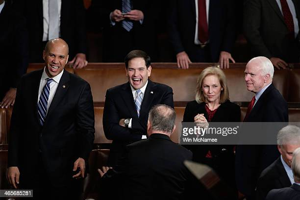 US Sen Cory Booker US Sen Marco Rubio US Sen Kristen Gillibrand and US Sen John McCain wait for US President Barack Obama to deliver the State of the...