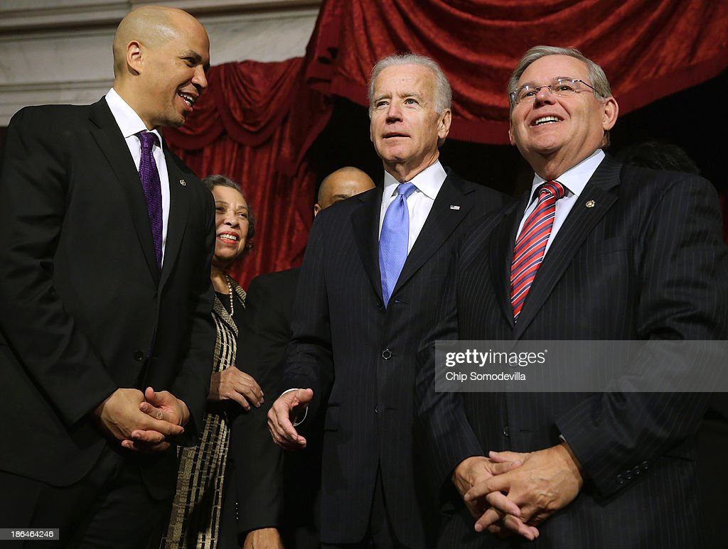 Sen. Cory Booker (D-NJ), Vice President Joe Biden and Sen. Robert Menendez (D-NJ) pose for photographs after Booker's ceremonial swearing-in in the Old Senate Chamber at the U.S. Capitol October 31, 2013 in Washington, DC. Booker defeated Republican Steve Lonegan in a special election to replace Frank Lautenberg, who died in June.
