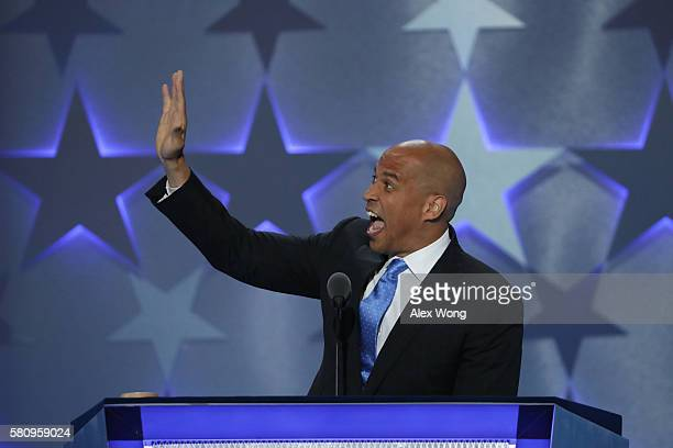Sen Cory Booker waves to the crowd before delivering remarks on the first day of the Democratic National Convention at the Wells Fargo Center July 25...