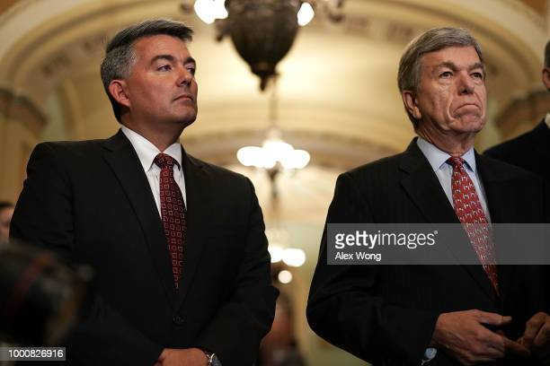 S Sen Cory Gardner and Sen Roy Blunt listen during a news briefing after a weekly policy luncheon July 17 2018 at the US Capitol in Washington DC...