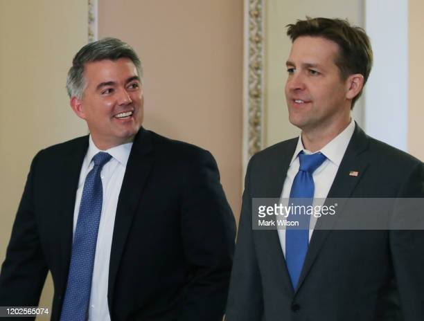Sen Cory Gardner walks with Sen Ben Sasse to the Senate Chamber to attend President Donald Trumps Senate impeachment trial at the US Capitol on...