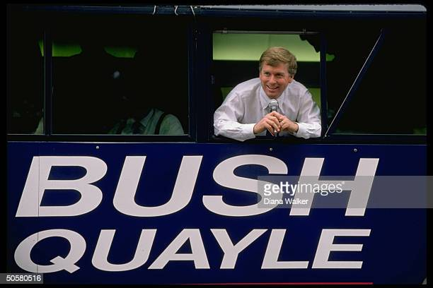 Sen. Dan Quayle, R-Ind. VP cand., leaning out of campaign bus w. BUSH/QUAYLE on side.