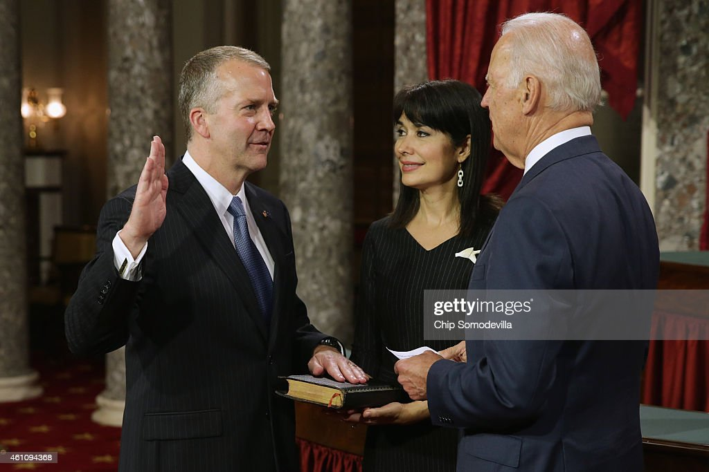Sen. Dan Sullivan (R-AK) (L) is ceremonially sworn in by U.S. Vice President Joe Biden in the Old Senate Chamber with Sullivan's wife Julie Fate Sullivan at the U.S. Capitol January 6, 2015 in Washington, DC. The 114th Congress convened on Tuesday, restoring control of both the House and Senate to the Republicans for the first time in eight years.