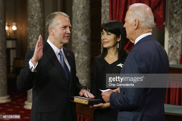 Sen Dan Sullivan is ceremonially sworn in by US Vice President Joe Biden in the Old Senate Chamber with Sullivan's wife Julie Fate Sullivan at the US...
