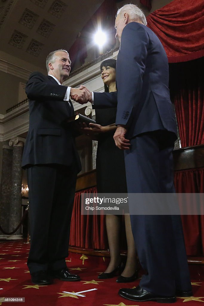 Sen. Dan Sullivan (R-AK) (L) is congratulated by U.S. Vice President Joe Biden during a cermonial swearing-in in the Old Senate Chamber with Sullivan's wife Julie Fate Sullivan at the U.S. Capitol January 6, 2015 in Washington, DC. The 114th Congress convened on Tuesday, restoring control of both the House and Senate to the Republicans for the first time in eight years.
