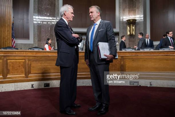Sen Dan Sullivan RAlaska right talks with Secretary of the Navy Richard V Spencer before a Senate Armed Services Subcommittee on Readiness and...