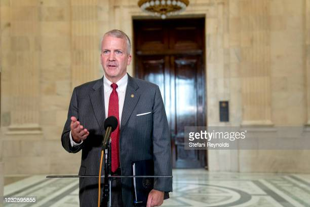 Sen. Dan Sullivan speaks to members of the media while arriving to Senate Republican policy luncheons at the Russell Senate Office Building on April...