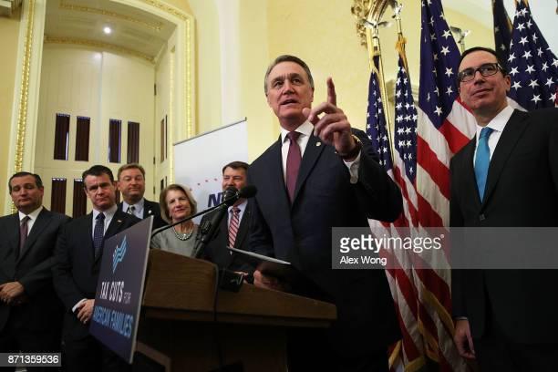 S Sen David Perdue speaks as Sen Ted Cruz Sen Todd Young Sen Dean Heller Sen Shelley Moore Capito Sen Michael Rounds and Secretary of the Treasury...
