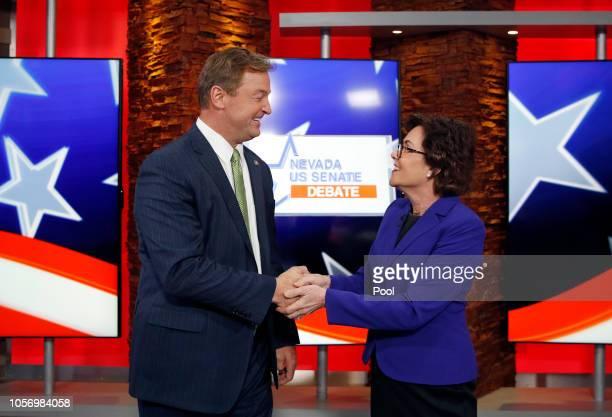 S Sen Dean Heller and US Rep Jacky Rosen shake hands before their debate at KLAS Channel 8 Studios on October 19 2018 in Las Vegas Nevada Rosen is...