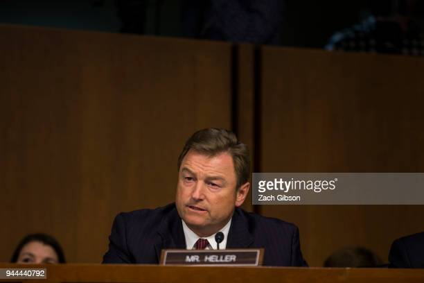Sen. Dean Heller asks questions as Facebook co-founder, Chairman and CEO Mark Zuckerberg testifies before a combined Senate Judiciary and Commerce...