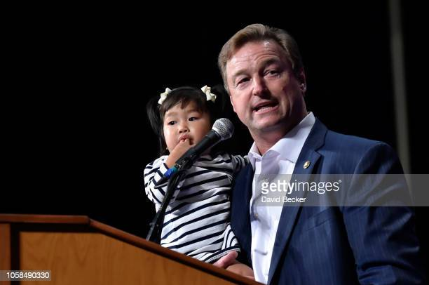 Sen. Dean Heller holds his granddaughter Ava as he speaks at the Nevada Republican Party's election results watch party at the South Point Hotel &...