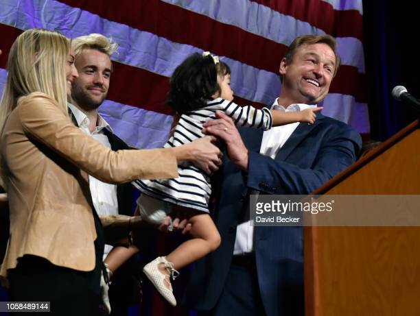 Sen. Dean Heller is handed his granddaughter Ava as he speaks at the Nevada Republican Party's election results watch party at the South Point Hotel...
