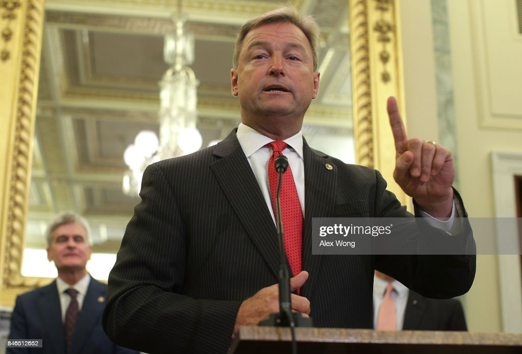 U.S. Sen. Dean Heller (R-NV) (R) speaks as Sen. Bill Cassidy (R-LA) (L) listens during a news conference on health care September 13, 2017 on Capitol Hill in Washington, DC. Senators Graham, Cassidy, Heller and Johnson unveiled a proposed legislation to repeal and replace the Obamacare.