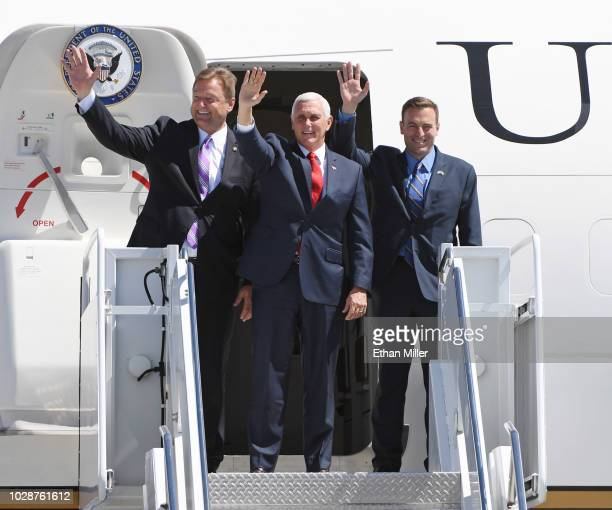 US Sen Dean Heller US Vice President Mike Pence and Nevada Attorney General and Republican gubernatorial candidate Adam Laxalt wave as they step off...