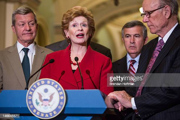 Sen Debbie Stabenow chair of the Senate Agriculture Committee speaks at a news conferece on Capitol Hill as Sen Max Baucus Sen Mike Johanns and Sen...