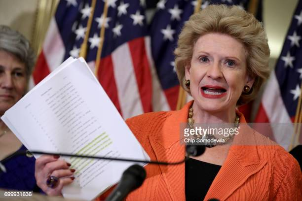 S Sen Debbie Stabenow holds a copy of the GOP proposed legislation that would repeal and replace Obamacare at the US Capitol June 22 2017 in...